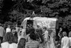 1960s Gathering Of Hippie Kids In Woods With Psychedelic Painted Van In Background Print By Vintage Collection - Item # PPI179346LARGE