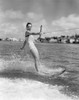 1950s Smiling Woman In Bathing Suit Water Skiing Waving One Hand Looking At Camera Print By Vintage Collection - Item # PPI176516LARGE
