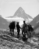 1920s-1930s Couple Man Woman Silhouetted Holding Hands Standing With Horses In Mountains Western Mt. Assiniboine Canada - Item # PPI177645LARGE