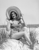 1920s-1930 Smiling Bathing Beauty Wearing Straw Hat Sitting On Beach Sand Dune Looking At Camera Print By Vintage - Item # PPI177001LARGE
