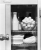 1930s-1940s Glass Front Door Refrigerator With Milk Bottle Bowl Of Eggs And Lettuce Print By Vintage Collection - Item # PPI177663LARGE
