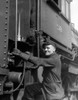 1930s Railroad Worker In Coveralls Hat Goggles & Gloves Climbing Up Onto Train Print By Vintage Collection - Item # PPI179042LARGE