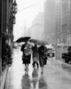 1950s Fashionable Woman Wearing Leopard Skin Muff And Stole Walking Down Rainy City Street Print By Vintage Collection - Item # VARPPI172475