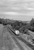 1950s Overhead View Of Streamlined Front Cab Diesel Locomotive Passenger Railroad Train Passing Through Suburban Area - Item # PPI178945LARGE