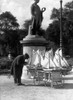 1930s Paris France Tuileries Gardens Man With Cart Of Miniature Toy Sailboats For Rent Print By Vintage Collection - Item # PPI178916LARGE