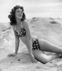 1950s-1960s Brunette Bathing Beauty Stretched Out On Sand Wearing Polka-Dot Bikini Looking At Camera Print By Vintage - Item # PPI177345LARGE