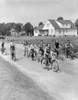 1950s Group Of 8 Kids Boys And Girls Riding Bicycles On Country Rural Road House In Background Print By Vintage - Item # PPI176982LARGE
