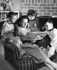 Close-up of a mid adult woman reading a storybook with her son and daughter Poster Print - Item # VARSAL2551413B
