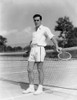 1930s Man Wearing Tennis Whites Standing Looking At Camera Holding Racket Hands On The Net Print By Vintage Collection - Item # VARPPI172473