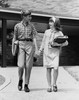 Schoolboy and a schoolgirl holding hands while walking Poster Print - Item # VARSAL25517724