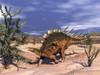 Kentrosaurus dinosaur walking in the desert to eat dicroidium plant Poster Print - Item # VARPSTEDV600243P
