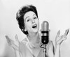 Young woman singing into a microphone Poster Print - Item # VARSAL2553365B