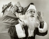 Close-up of Santa Claus carrying a sack of gifts on his back Poster Print - Item # VARSAL25523856