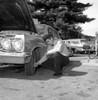 Man repairing car Poster Print - Item # VARSAL255416394