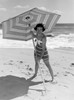 Young woman holding sun umbrella on beach Poster Print - Item # VARSAL255416424