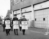 Group of people walking on a street holding placards Poster Print - Item # VARSAL25544279