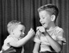 Two boys pulling a wishbone and smiling Poster Print - Item # VARSAL25516519A
