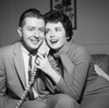 Young couple on the phone Poster Print - Item # VARSAL255418048