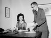 Businessman showing document to businesswoman Poster Print - Item # VARSAL25548759