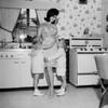 Mother embracing children in kitchen Poster Print - Item # VARSAL255417656