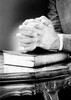 Folded hands on top of Bible Poster Print - Item # VARSAL255422496