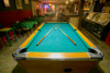 Pool table lit by electric lights in a restaurant and bar in Shoshone, CA near Death Valley National Park Poster Print by Panoramic Images - Item # VARPPI181852