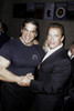 Arnold Schwarzenegger and Lou Ferrigno shaking hands at the 25th Anniversary of Pumping Iron event Photo Print - Item # VARGLP363683