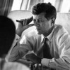 President John F Kennedy sitting on a airplane Photo Print - Item # VARCEL683745