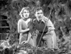 Most Dangerous Game Woman Holding Her Man's Shoulder and Hiding in The Cave in Black and White Photo Print - Item # VARCEL702314