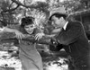 Katharine Hepburn Leaning on Tree with a Man Talking in Black and White Photo Print - Item # VARCEL699199