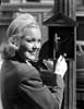 Jane Wyman Posed in Black Velvet Long Sleeve Suit Dress and White Hat Photo Print - Item # VARCEL705866