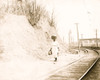 African American woman with basket on head walking near railroad tracks Poster Print - Item # VARBLL0587632127