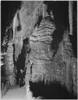 """Path and rock formations man on path """"Large Formation at the 'Hall of Giants' in Carlsbad Cavern' Carlsbad Caverns National Park"""" New Mexico. 1933 - 1942 Poster Print by Ansel Adams - Item # VARBLL0587401478"""