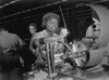 African American Woman Lathe Operator At A Midwest Supercharger Plant. In The Background Are White Workers In The Racially Integrated Workforce During World War 2. Ca. 1942-45. History - Item # VAREVCHISL036EC817