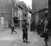 U.S. Soldier Aims At A German Sniper During Street Fighting In Saint Malo History - Item # VAREVCHISL037EC138
