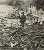 American M.P. Standing On A Large Pile Of Italian Weapons On A Street In Palermo History - Item # VAREVCHISL020EC168