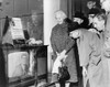 People Gather Around A Television Outside A Store Window On A New York Street As President John F. Kennedy Speaks During A Press Conference On November 21 History - Item # VAREVCHISL020EC147