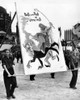 Communist Youth Organizations Put On A 'Peace' Parade. A Group Of Teenage Boys Carry An Anti-American Sign Depicting General Dwight Eisenhower Riding On The Back Of West German Chancellor Konrad Adehauer. March 14 History - Item # VAREVCCSUA001CS644