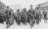 British And American Prisoners Of War Marching Through Rome Under Guard Of German Soldiers. Approximately 400 Allied Ranger Pows Were Survivors Of A Failed Raid On Cisterna Of Jan. 30 History - Item # VAREVCHISL037EC976