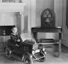 Little Boy In His Toy Automobile Next To A State Of The Art Atwater Kent Radio. The Radio Features Enclosed Speakers Behind The Fabric Covered Openings In The Refined Cabinet History - Item # VAREVCHISL043EC238