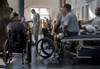 Chief Of Staff Of The Army General George W. Casey Center Left Talks With A Wheel Chair Bound Soldier While Other Wounded Do Their Physical Therapy At The Center For The Intrepid Fort Sam Houston Texas. Nov. 17 2008. - Item # VAREVCHISL027EC289