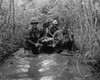 Vietnam War. Us Soldiers Carry A Wounded Comrade Through A Swampy Area. 1969. History - Item # VAREVCHISL033EC594
