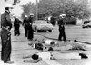 Police Officers Stand Over Suspected Looters During The Fourth Day Of Riots In Watts History - Item # VAREVCHBDRIOTCS009