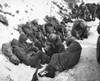 U.S. Marines Catch A Few Moments Rest During Their Withdrawal From The Chosin Reservoir. Dec. 6 History - Item # VAREVCHISL038EC334