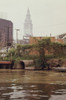 A Cleveland City Pump Station Discharges Sewage Into The Cuyahoga River. In The Background Is The Terminal Tower A Landmark Skyscraper In Downtown Cleveland. Ca. 1973-75. History - Item # VAREVCHISL031EC266