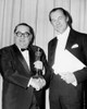 1964 Producer Joseph E. Levine Is Congratulated By Best Actor Rex Harrison Upon Receiving The Cecil B. De Mille Award History - Item # VAREVCSBDOSPIEC012