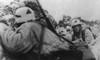 German Soldiers Crouching Behind Earthworks Near Leningrad During Soviet Bombardment. Ca. 1943 During World War 2. History - Item # VAREVCHISL037EC716