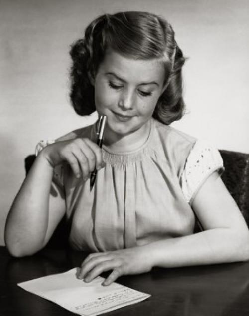 Portrait of teenage girl writing letter Poster Print - Item # VARSAL25514345