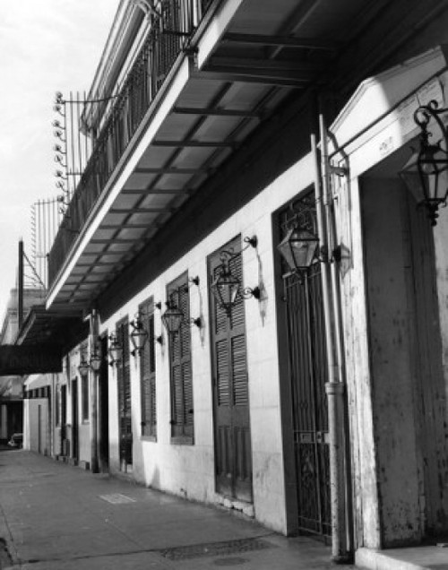 USA  Louisiana  New Orleans  sidewalk and building with closed window shutters  1950s  Poster Print - Item # VARSAL25529032