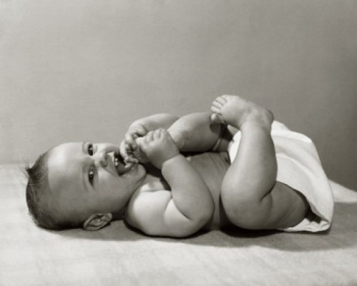 Close-up of a baby lying on the floor Poster Print - Item # VARSAL2559355